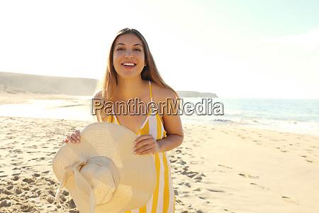happy cheerful girl in summer dress
