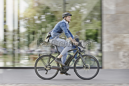 student on his e bike at