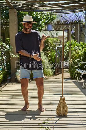 man having fun with a broom