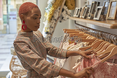 woman choosing new clothes to buy