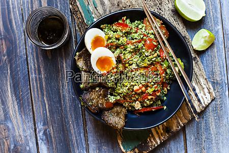 thai style fried broccoli riceshreddedbroccoliwith beef
