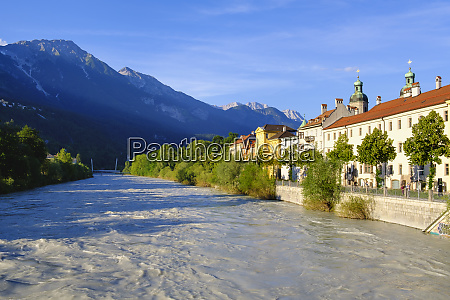 inn with cathedral by river at