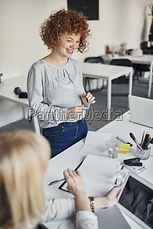 smiling businesswoman leading a meeting in