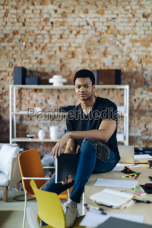 portrait of confident young man at