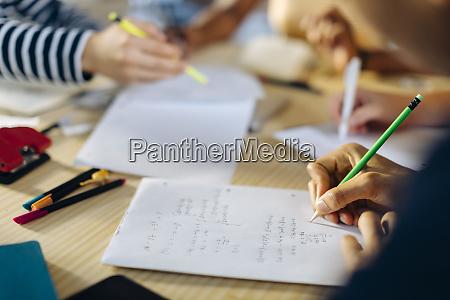 close up of young man writing