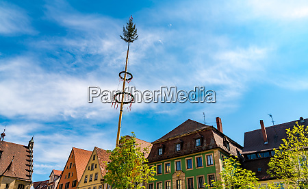 historic architecture with traditional maypole in