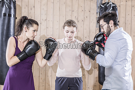 man and woman fighting with girl
