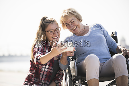 young woman with her smiling grandmother