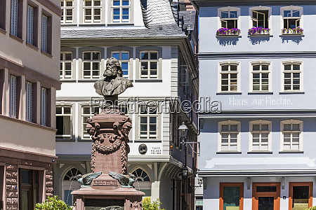 stoltze fountain against buildings in frankfurt