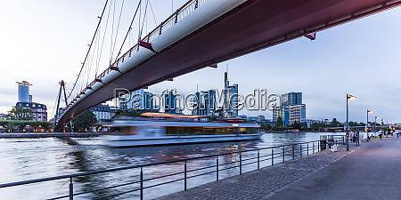 holbeinsteg footbridge over river at dusk