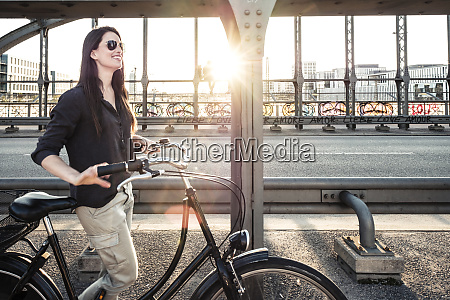 young cyclist on a bridge at