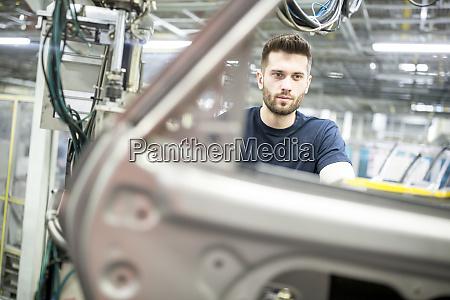 man, working, in, modern, car, factory - 28036628