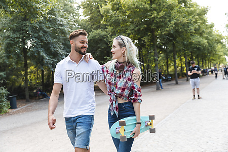 happy young couple walking in a