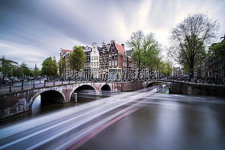 netherlands amsterdam light trails along city