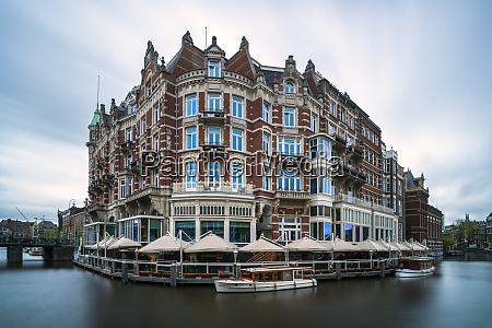 netherlands amsterdam cafe canopies surrounding waterfront