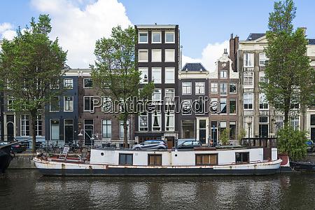 netherlands amsterdam barge moored along edge