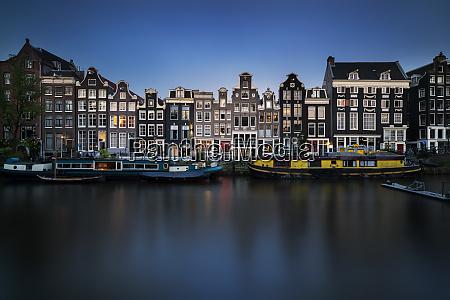 netherlands amsterdam various boats moored along