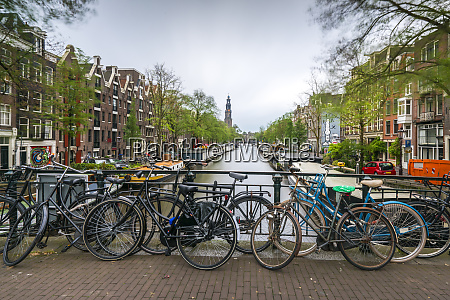 netherlands amsterdam bicycles parked along railing