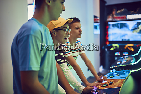 teenage friends playing with a gaming