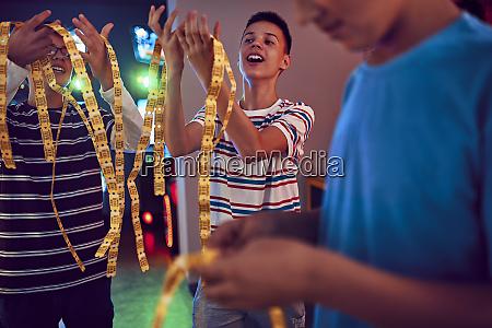 teenage friends having fun with tickets
