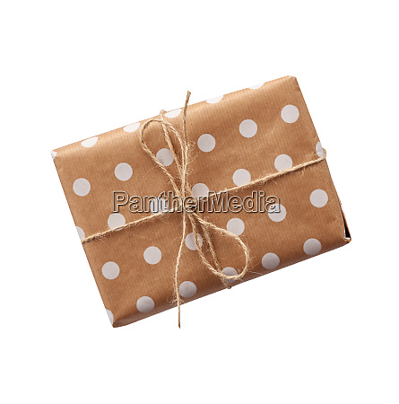 gift in box wrapped in brown