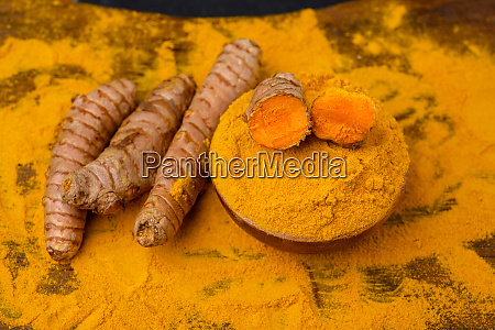fresh whole and sliced turmeric roots