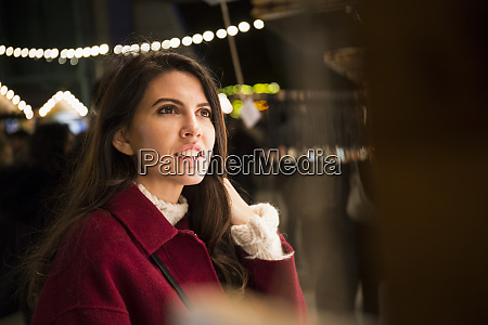 portrait of young woman watching offers