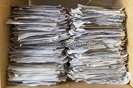 pile of papers in shelf close