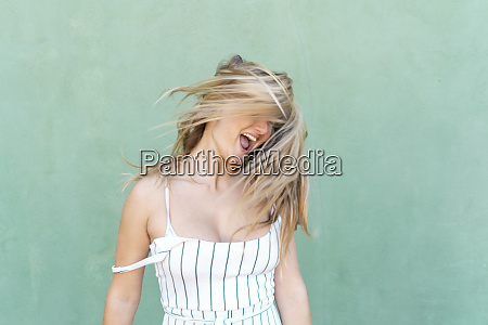 blond young woman screaming and tossing