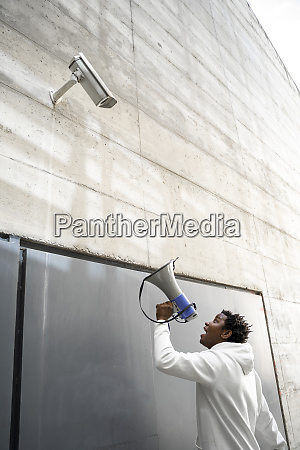 mature man holding megaphone and screaming