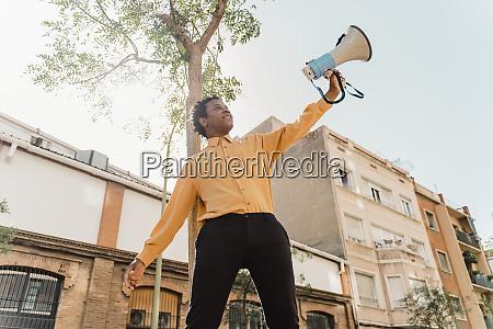 mature man using megaphone and screaming
