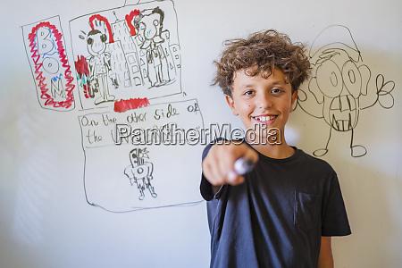 portrait of happy boy in front