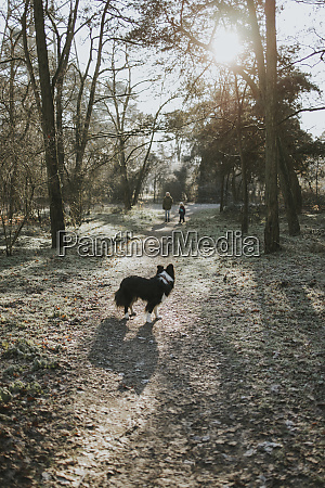 mother and daughter with border collie