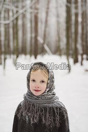 portrait of little girl wearing headscarf