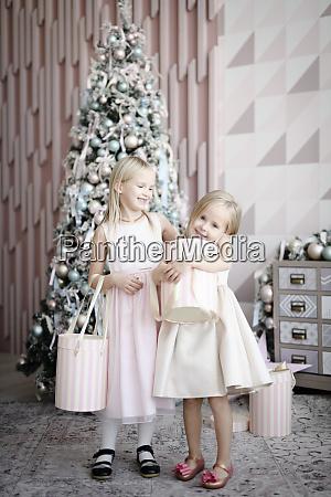 portrait of two happy little girls