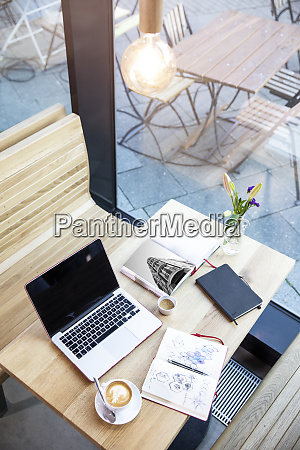 laptop and books on table in