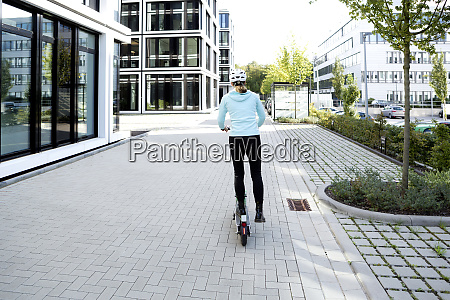 mature woman riding electric scooter in