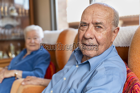 elderly man with his wife sitting