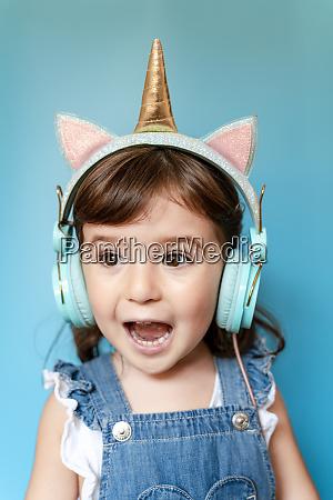 portrait of cute little girl listening