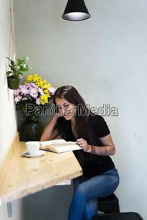 young woman reading a book in