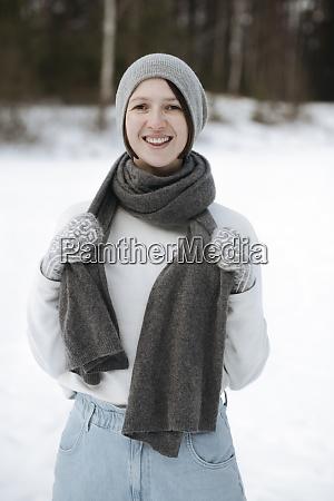 portrait of happy woman standing on