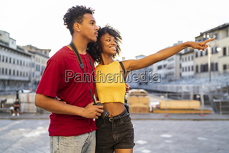 happy young tourist couple exploring the