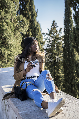 female tourist with camera outdoors