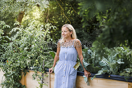 blond woman standing in front of