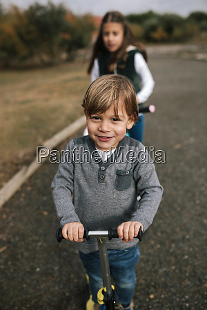 portrait of little boy with scooter