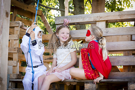 three kids with superheroes costumes playing