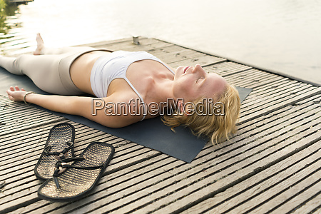 young woman lying on a jetty