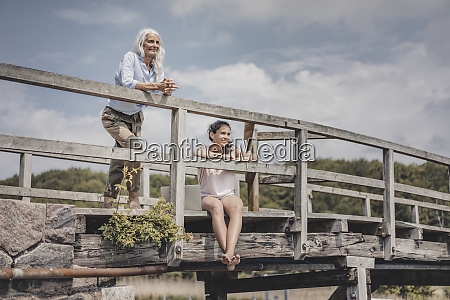 mother and daughter looking at view
