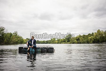 businessman sitting on a float a