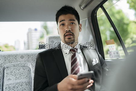 young businessman with cell phone in